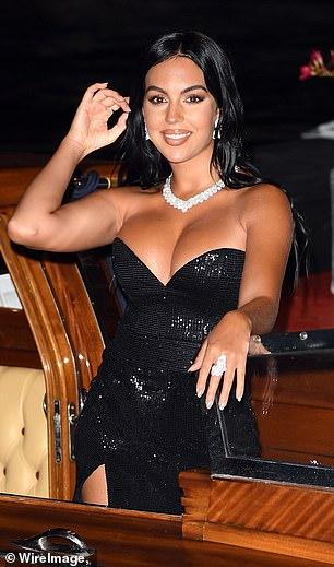 Beaming: She added further sparkle to her evening look with a stunning diamond necklace and a pair of matching earrings, as well as two huge dazzling rings