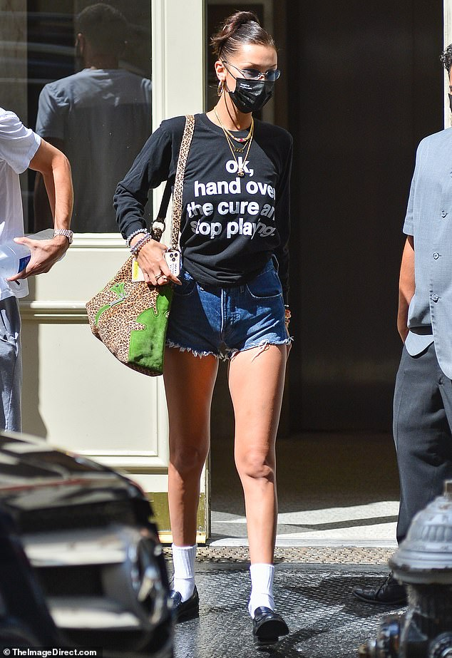 Statement:On Thursday, the supermodel was seen in New York City showing off her legs in a pair of jean shorts, while also wearing a striking slogan long sleeved T-shirt