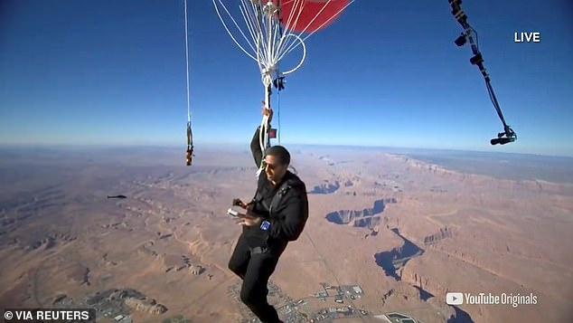 Blaine, who was equipped with a parachute, live streamed the stunt over Page, Arizona
