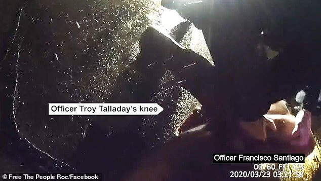 Officer Talladay is seen placing a kneww into Prude's back as he lay on the floor