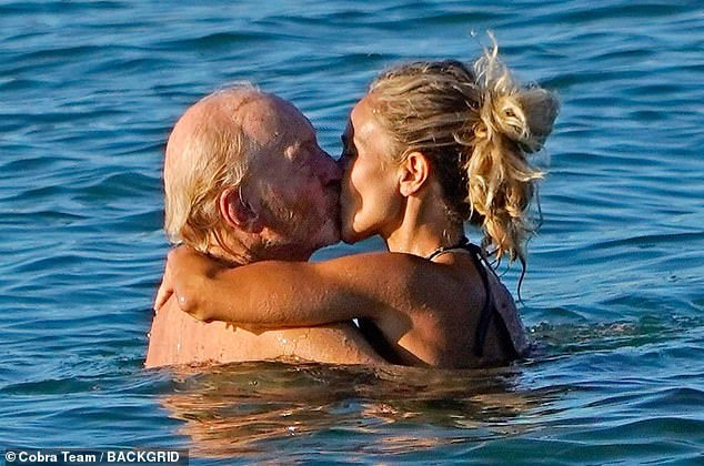 Cosy: The pair moved in for a sweet kiss as they enjoyed the cool water in each other's arms