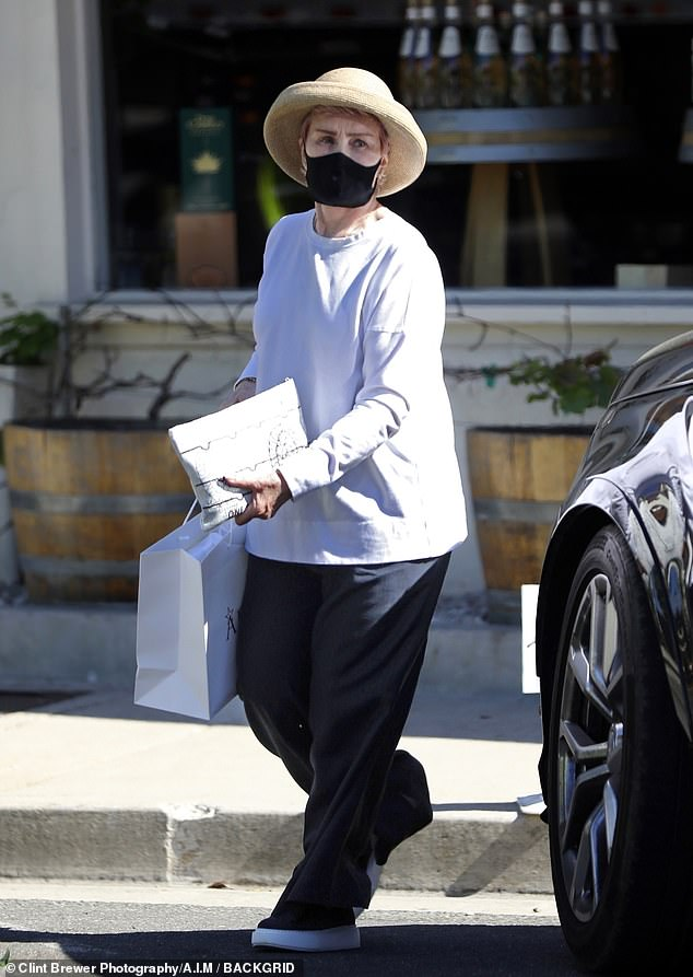 Out shopping: Sharon Osbourne was spotted out in Los Angeles on Thursday, this time in the upscale shopping enclave of Larchmont Village in the middle of the city