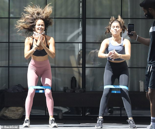 Jumping:While working on her core muscles, Burke flashed a bright smile and her glowing summer tan