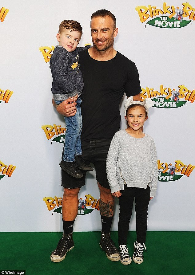 Family: Commando is father to four children, daughter Brianna, 21, from a previous relationship, daughter Ella, 12, and son Jack, nine, with his ex Froso, and son Axel, four, with Michelle Bridges. Ella and Jack are pictured