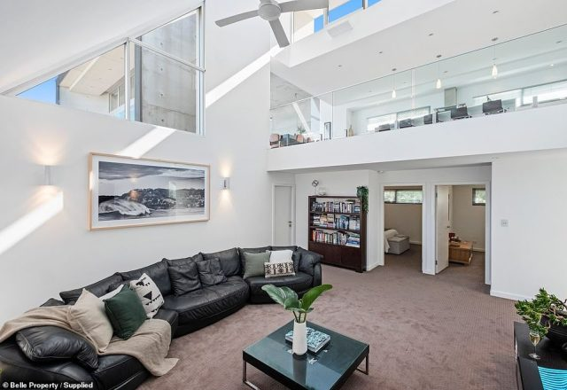 While the exterior of the property is striking, the interior is just as special, thanks to multiple open-plan entertaining spaces (one of the living areas pictured)
