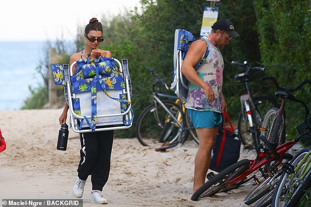Dropping off:Once they arrived to the beach, Emily and Sebastian dropped their bikes off at a nearby bike rack