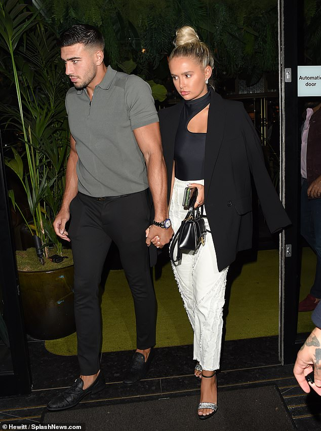 Loved-up:Molly-Mae Hague and her boyfriend Tommy Fury appeared as loved-up as ever on Thursday evening, as they left Amazonico restaurant in Mayfair, London