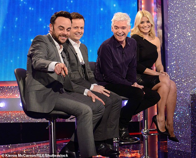 Close pals: Dec admitted he was 'strange' presenting without longtime friend Ant. Luckily he and longtime friend Holly went down a storm with viewers (pictured with Phillip in 2017)