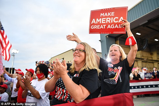 Supporters of US President Donald Trump cheer during a campaign event at Arnold Palmer Regional Airport