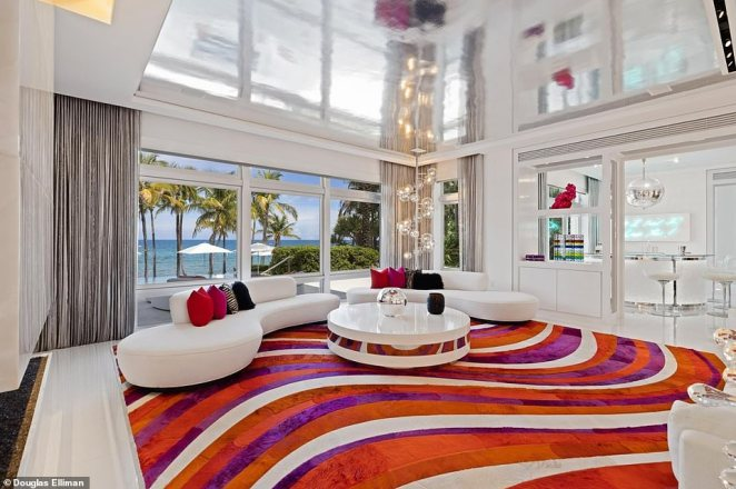 Living room: The flamboyant property boasts bold and colorful interior deign choices as well as stunning ocean views