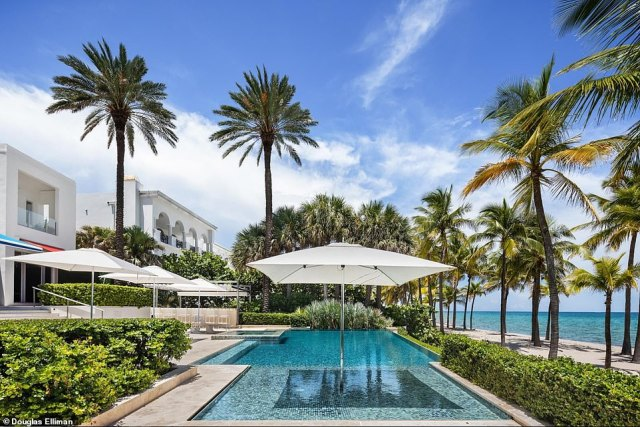 Florida estate: The property offers plenty of room for outdoor living and recreation. There's an infinity pool and adjoining lounge area with built-in barbecue, bar and fire pit