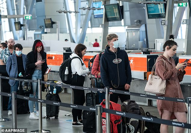Passengers queuing to check in for flights to Queensland at Sydney Domestic Airport in July