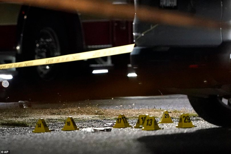 Evidence markers are placed on the ground last night in Lacey, Wash. at the scene where Michael Reinoehl was killed Thursday night as investigators moved in to arrest him. Reinoehl had been suspected of fatally shooting a supporter of a right-wing group in Portland, Oregon, last week after a caravan of Donald Trump backers rode through downtown Portland.