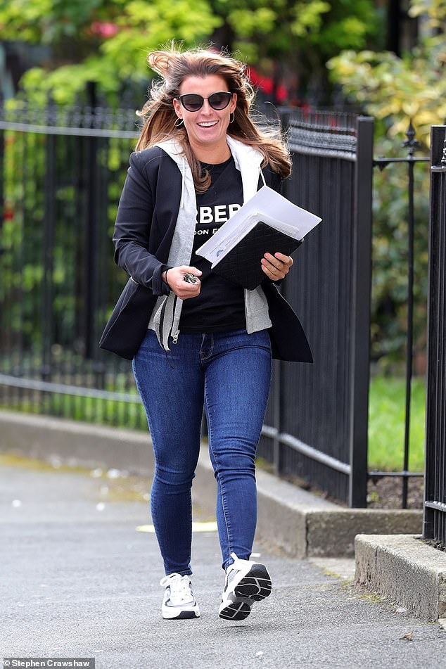 Cosy: Coleen completed the look by shrugging on a black blazer over a grey hoodie, while she decided to forgo bringing a bag to keep her personal items