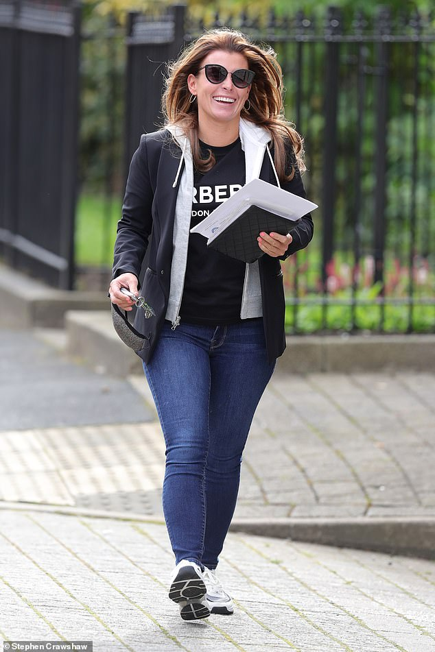 Amused: Coleen Rooney put on a cheerful display as she left her salon in Cheshire on Friday... after finding Rebekah Vardy's 'tactics to speed up £1million lawsuit laughable'
