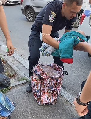 The officers reportedly put the baby in the back seat of their car and called an ambulance.