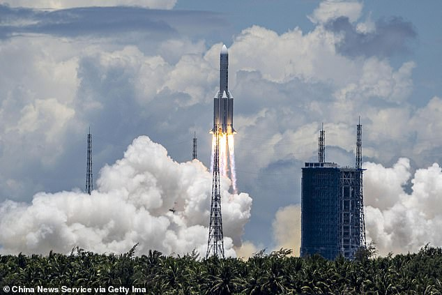 A Long March-5 rocket carrying an orbiter, lander and rover as part of the Tianwen-1 mission to Mars, blasts off from the Wenchang Space Launch Centre on July 23 in Hainan, China