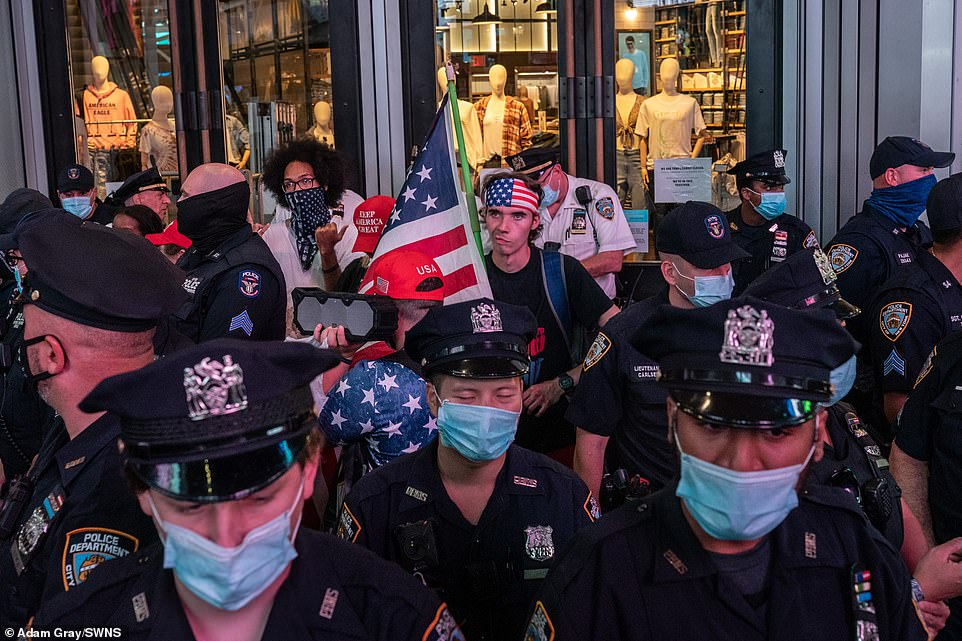 NBC quotes police sources as saying the driver was 'was found to be a part of the Keep America Great rally' and that the group had 'exchanged heated words' with the BLM supporters. Photographs taken at the time show cops trying to keep the two groups apart