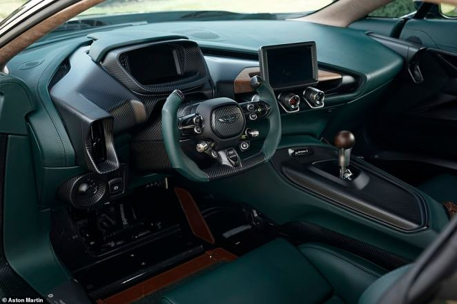 There are walnut sections throughout the car, including the base for the infotainment screen. The manual gearknob is also made from a single piece ofCrown cut solid wood