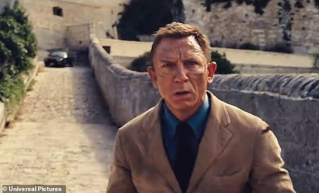 The biting video opens with 007 (pictured) narrowly avoiding being hit by a car before crashing into a wall as he embarks on one of his most dangerous missions to date