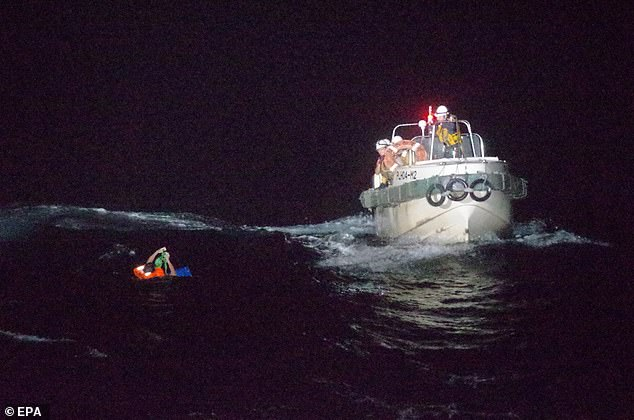 Survivor Sareno Edvarodo, from the Gulf Livestock One, is pulled to safety by rescuers