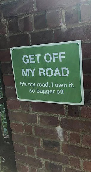 Another reads: 'Get off my road, it's my road, I own it so bugger off'