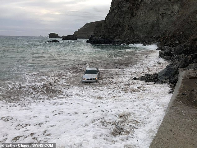 Witnesses say the driver of this vehicle is believed to have left it parked on the beach in Cornwall late at night