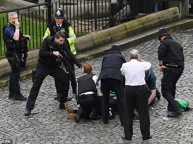 Hundreds of inmates jailed for non-terror offences who are feared to hold extremist sympathies could be refused the right to automatic release (pictured, the Westminster terror attack)