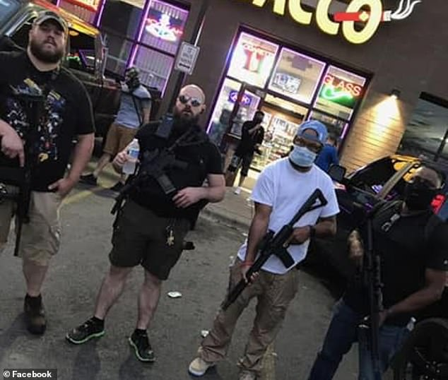 Solomon (standing left) is seen on May 27 during protests and riots in Minneapolis. He said at the time that he supported the protests, but was opposed to riots and looting