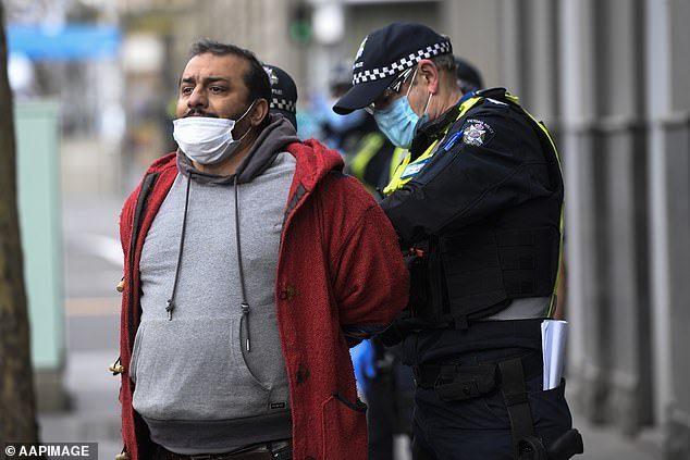 Police have warned anybody attending the rallies will be hit with massive fines (pictured man is detained at an anti-lockdown protest in Melbourne last month)