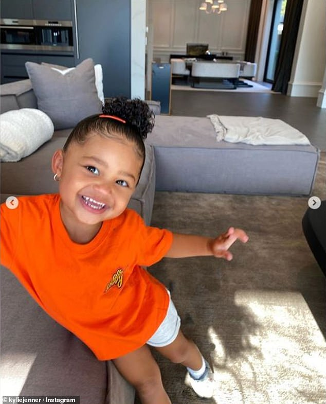 Natural: Stormi looked natural in front of her mom's camera as she posed for photos in the spacious living room of their Holmby Hills, Calif., Mansion