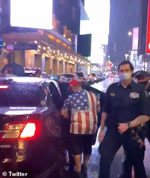 Video shows NYPD officers escorting Pro-Trump counterprotesters to the car that would later be seen plowing through a crowd of protesters in NYC's Times Square Thursday night