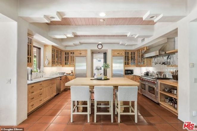 Kitchen porn: The kitchens feature wall-to-wall wood with natural finish, as well as stainless steel appliances