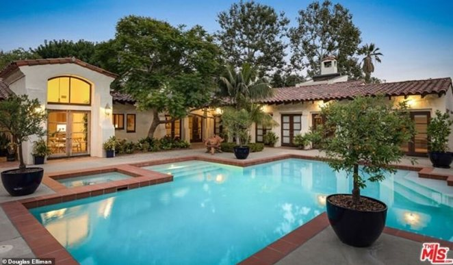 Dive in: The sprawling estate comes with several living and dining areas, two state-of-the-art gourmet kitchens, two swimming pools and two spas