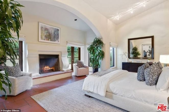 Cozy escape: One master suite comes with arched walls and a cozy fireplace