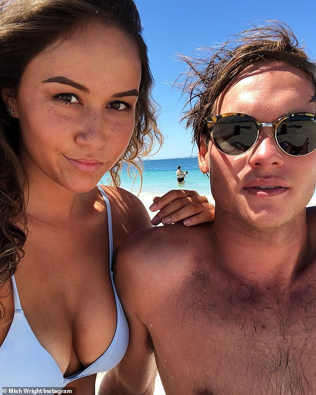 Phil Mummert (right), 28, was surfing at Bunker Bay, in the Bunker Bay, south of Perth, when the five-metre shark bit his right thigh and took a chunk of his surfboard around 2.15pm on July 31 (pictured with girlfriend Ms Wright)