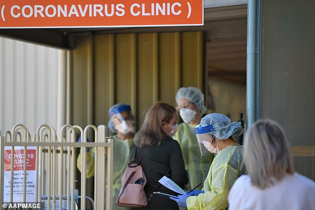 People wait outside the Tanunda War Memorial Hospital, a dedicated COVID-19 testing clinic to deal with the expected uptick in cases in the Barossa Valley