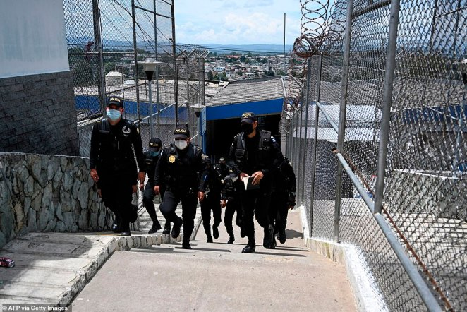 Police carry out an inspection at the 'Mara 18' gang wing in Guatemala City yesterday