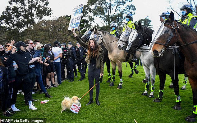 Protesters confront police at the Shrine of Remembrance in Melbourne