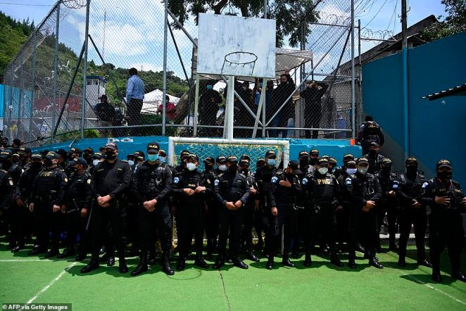 Dozens of police officers can be seen while carrying out an inspection of the Mara 18 gang wing in a Guatemala City prison yesterday