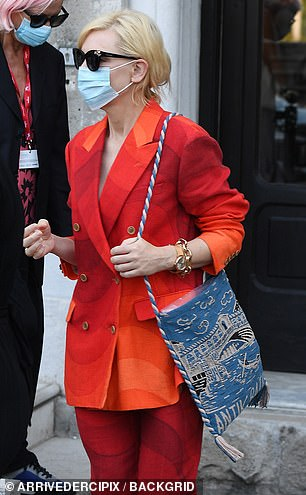 Meow: Cate wore her cropped blonde locks loose and shaded her eyes with a pair of catseye sunglasses