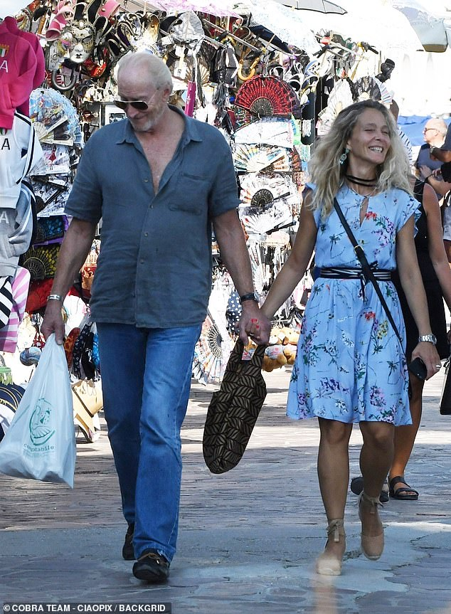Besotted: The couple appeared in the throes of love as they strolled through the city and stopped off at an ice cream parlour