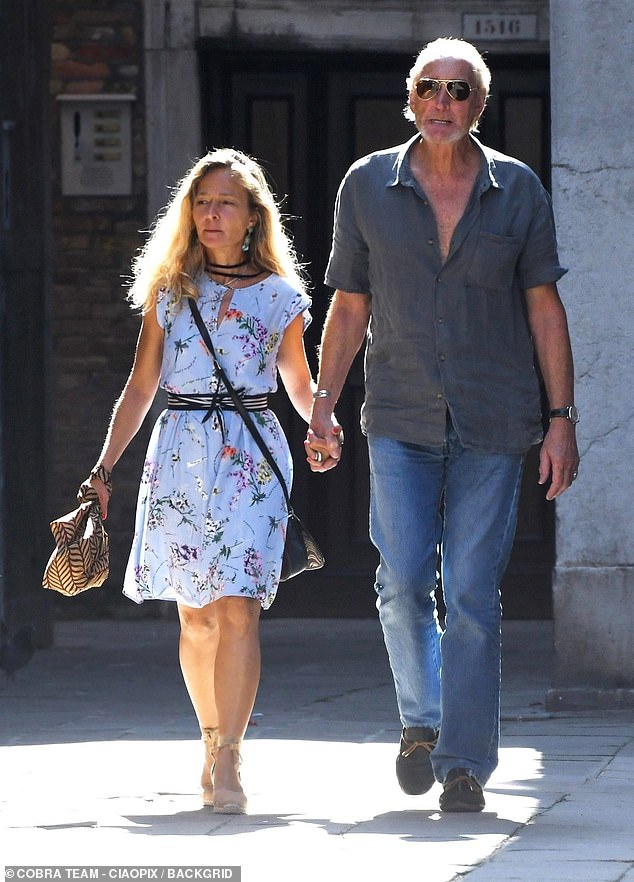 Loved-up:Charles Dance and his new Italian film producer girlfriend enjoyed a romantic walk in Venice on Friday, a day after they passionately kissed one another in the sea