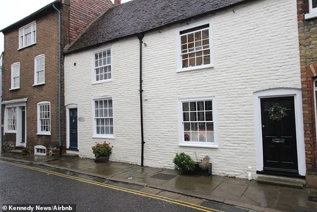 The online advert for Bobbit's Lair cottage (pictured from the outside) had a ban on guests who weighed more than 100kg (15.7 stone)
