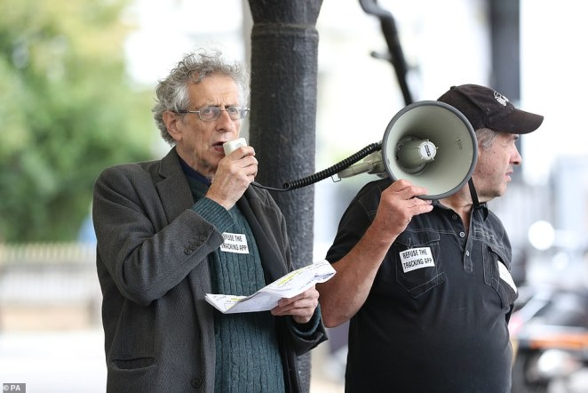 Piers Corbyn (left) the brother of former Labour Party leader Jeremy Corbyn, speaking at a Stop New Normal protest at Portobello Green in London