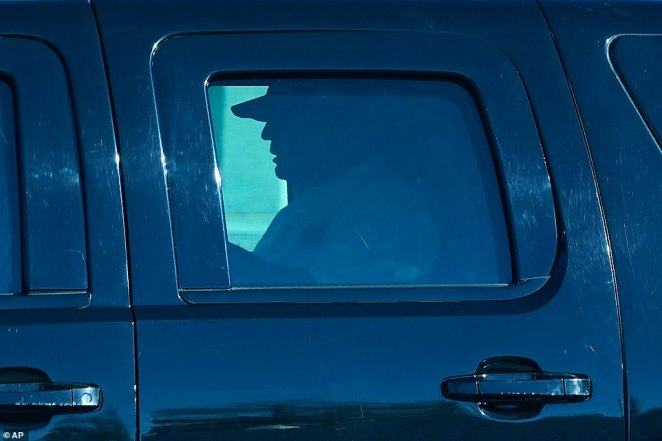 President Donald Trump departs the White House in Washington on Saturday as his motorcade took him to Trump National Golf Club in Sterling, Virginia