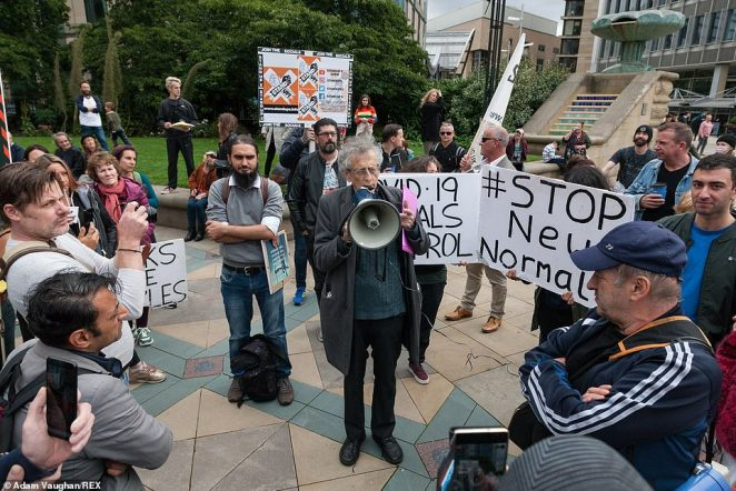 In Sheffield, protestors at the rally held signs saying 'stop new normal' and 'freedom over fear'