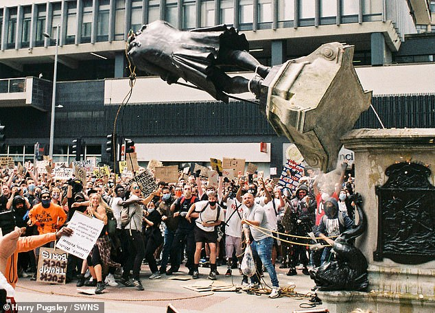 DOUGLAS MURRAY: Ever since the terrible killing of George Floyd – an unarmed black man – by a white police officer in the US, the radical activists have redoubled their efforts to persuade us that Britain and all other Western democracies are racist and intolerant societies (pictured: the statue of Edward Colston pulled from its plinth in Bristol, June 7, 2020)