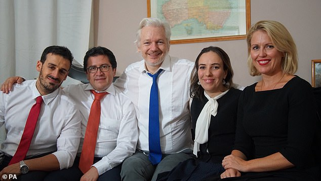 Spanish counsel Aitor Martinez, Ecuadorian counsel Carlos Poveda, Julian Assange, his partner Stella Morris-Smith Robertson and barrister Jennifer Robinson are pictured