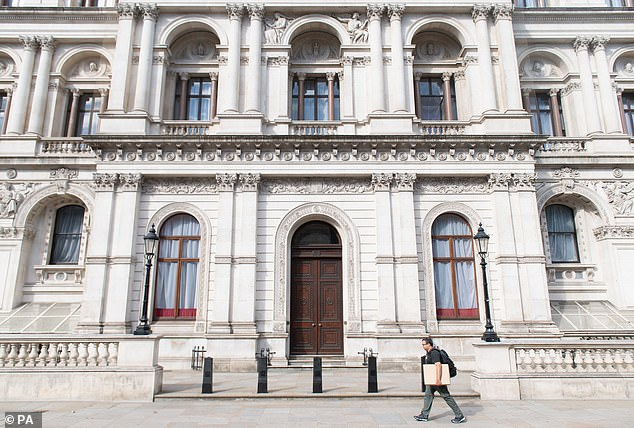 A man walks past the Foreign and Commonwealth Office, on Whitehall. MPs have accused the Civil Service of making a 'mockery' of Boris Johnson's push to get staff back into the office by advertising 'work from home only' jobs